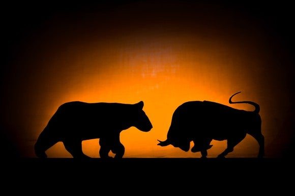 A bull and bear in silhouette.