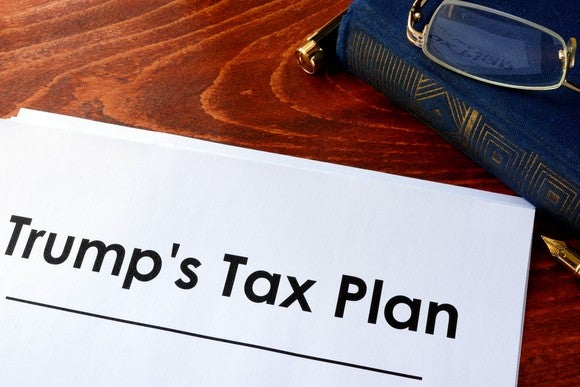 "A stack of papers on a desk with the words ""Trump's tax plan"" on top"