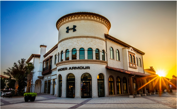 "Sun rising over Under Armour ""Brand House"" retail store."