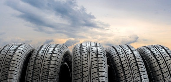 Tires lined up outside at sunset.
