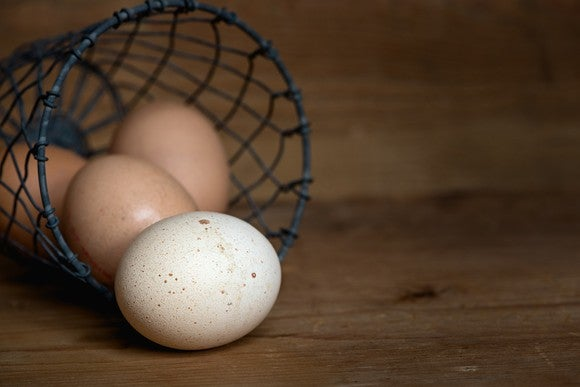 A basket with eggs rolling out.