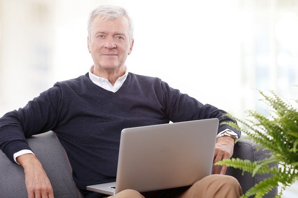 Senior male with laptop