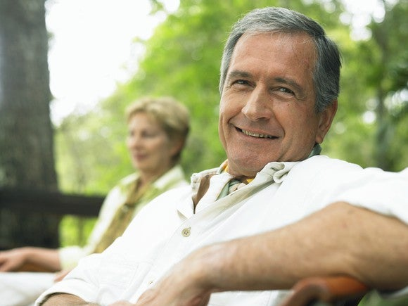 Older couple smiling in a garden