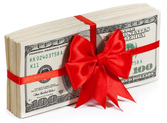 A stack of bills, wrapped in red bow