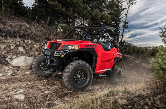A red Polaris Industries General 1000 UTV on a rocky dirt road