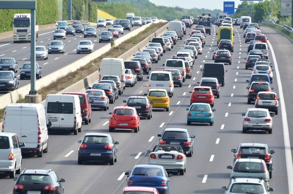 Picture of cars in traffic on the highway.