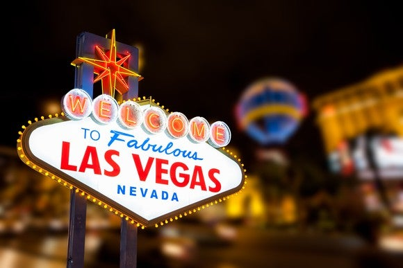 Las Vegas sign with strip street background.