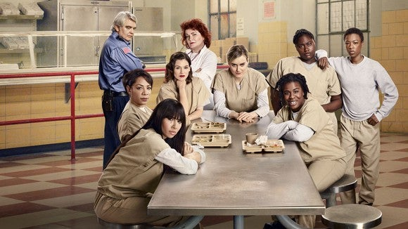 """The main cast of """"Orange Is the New Black,"""" in character."""
