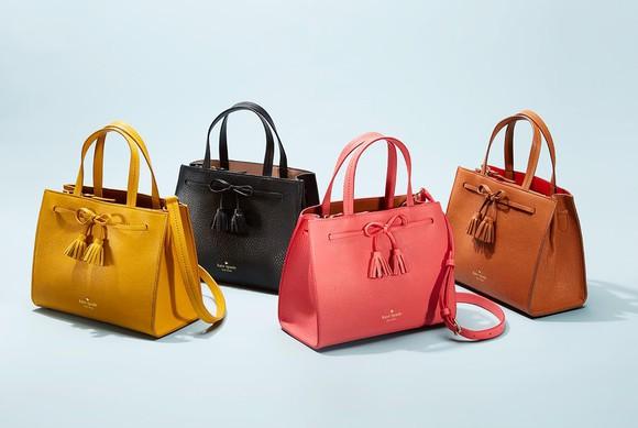 Four Kate Spade handbags.