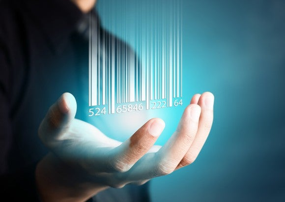 Hand grasping digital representation of barcode