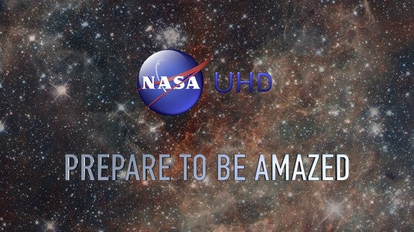 The NASA logo over a backdrop of stars with the text