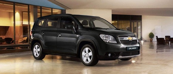 A black Chevrolet Orlando station wagon.