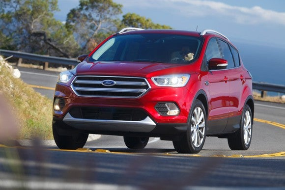 Front view of Ford's 2017 Escape as it climbs a winding road.