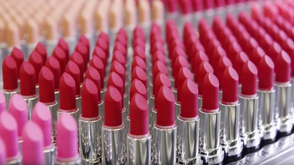 An army of red lipstick tubes in a square formation.