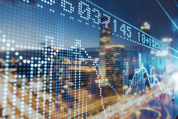 A animation of a stock chart laid over the image of a city scape.