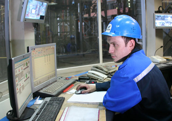 A Mechel PAO employee working in a control room