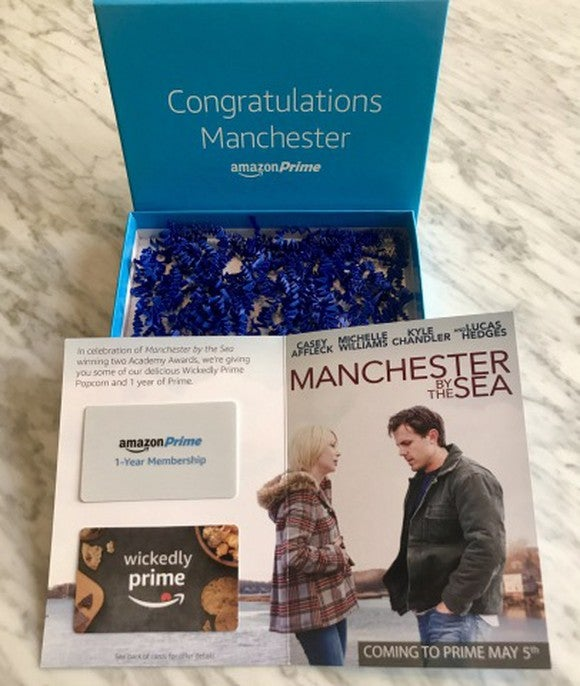 Gift box containing two gift cards on card showing movie image.