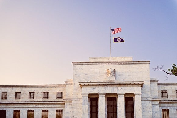 The U.S. Federal Reserve Building at sunset.