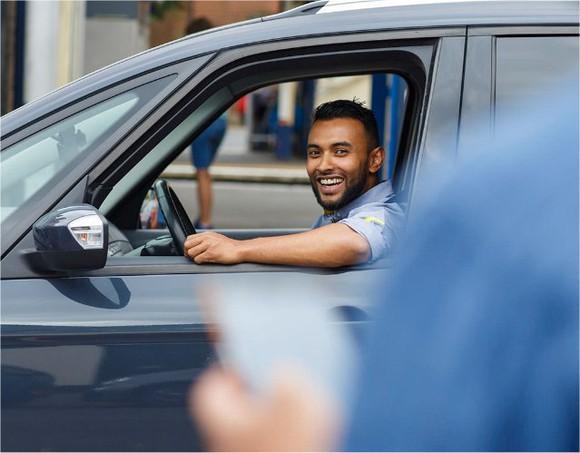 An Uber driver picks up a passenger.
