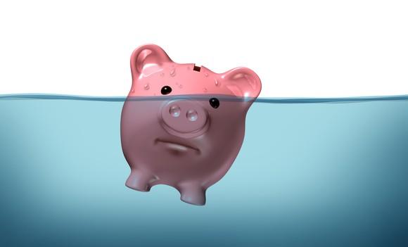 Piggy bank half underwater