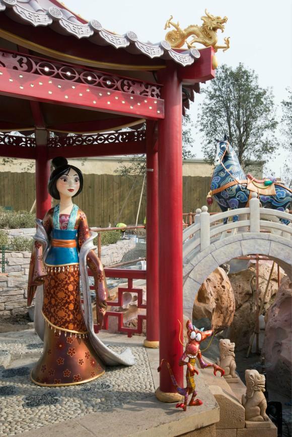 Mulan stands inside a pagoda at Disney's Shanghai resort.