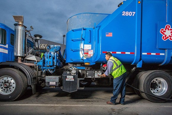Republic services trash truck refueling with CNG.