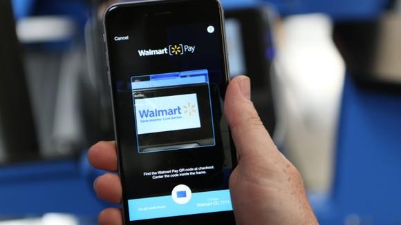 A customer using Walmart Pay to check out at a Wal-Mart.
