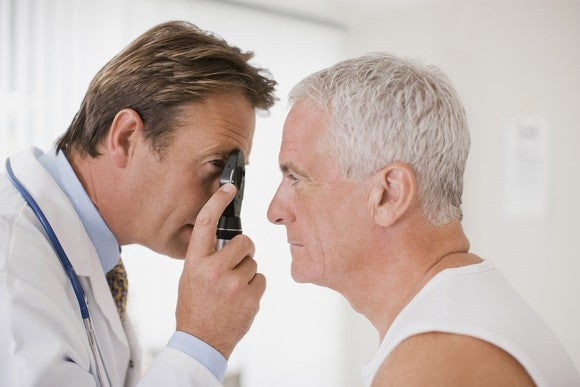 Doctor examining patient's eye