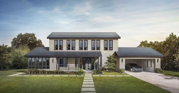 A home with Tesla Smooth Glass solar tiles, a Model S, and two Powerwalls