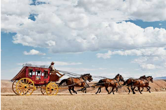 The Wells Fargo stagecoach driving across the plains.
