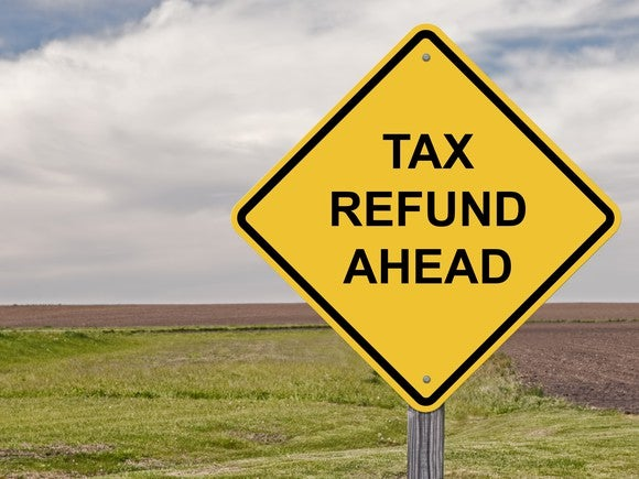 "Yellow traffic sign that says ""tax refund ahead"""