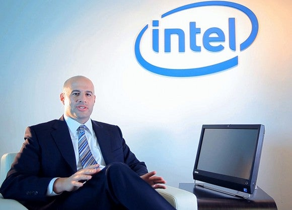 Intel's Gregory Bryant sitting next to a computer.