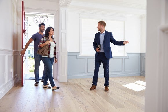 A realtor giving a home tour.
