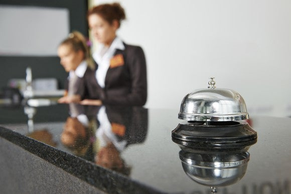 Hotel reception desk with service bell.