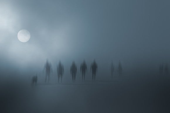 Mysterious blurred people walking in the fog.