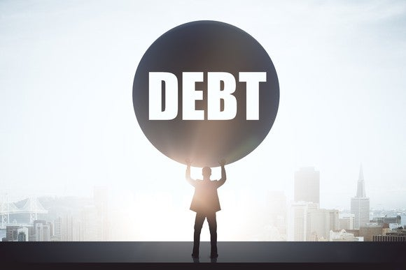 Person holding up a ball of debt