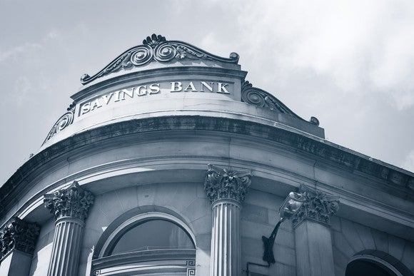The front of a building that says Savings Bank at the top.