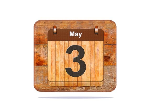 "A wooden calendar showing a number three and the word ""May."""