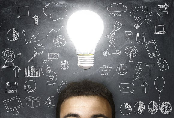 A man with a light bulb shining above his head.