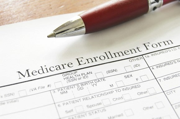 Close up of Medicare enrollment form, with part of pen showing, too