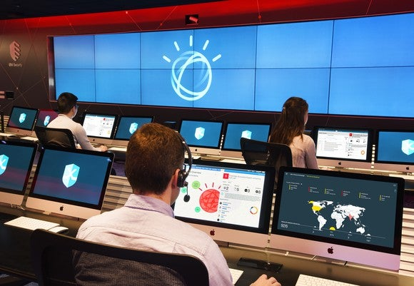People sitting at desks using IBM's Watson AI