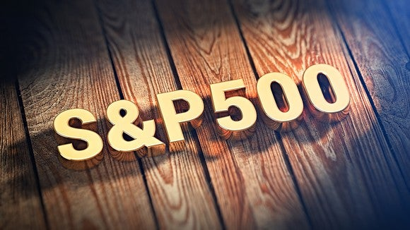 """S&P 500"" in 3-D, over planks of wood or a wood floor"