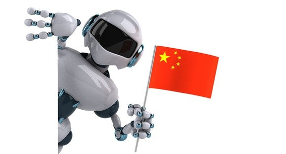 A robot holds a Chinese flag.