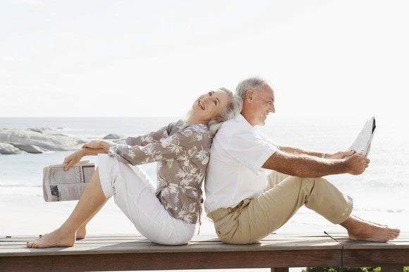 older couple happy near water