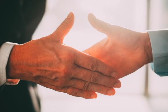 A businesslike handshake.