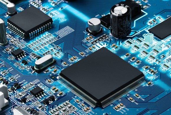 A circuit board shows several different types of semiconductors soldered to a motherboard