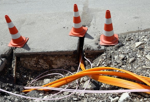 Fiberoptic cables being laid in the ground.