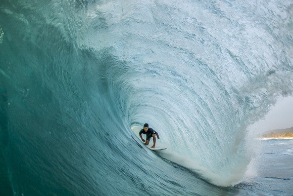 A surfer riding the waves.