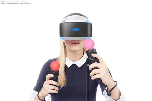 A lady uses Sony's Playstation VR headgear
