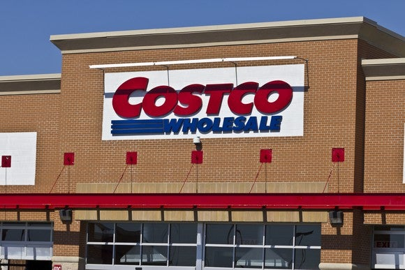 Costco Wholesale sign at the top of a brick building facade.
